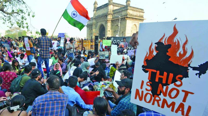 People protest against the alleged attack on JNU students at Gateway of India on Monday. (Photo: Debasish Dey)