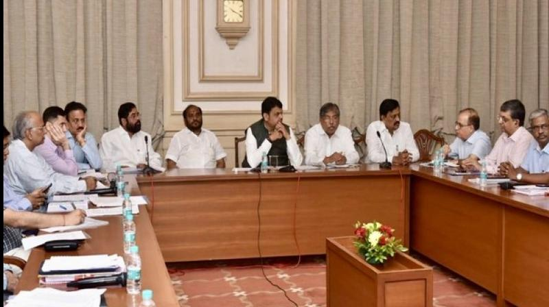 While addressing the meeting, Fadnavis directed the officials to make alternate arrangements for food and drinking water for flood-affected people in various districts. (Photo: ANI)