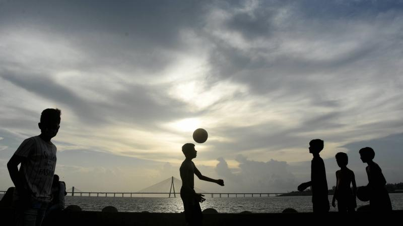 Children play football along the sea-facing promenade of Mahim Chowpaty during evening hours, amid the ongoing COVID-19 nationwide lockdown, in Mumbai. PTI photo