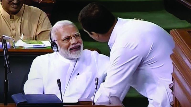 Congress president Rahul Gandhi with Prime Minister Narendra Modi after his speech in the Lok Sabha on the no-confidence motion during the Monsoon Session of Parliament. (Photo: PTI)
