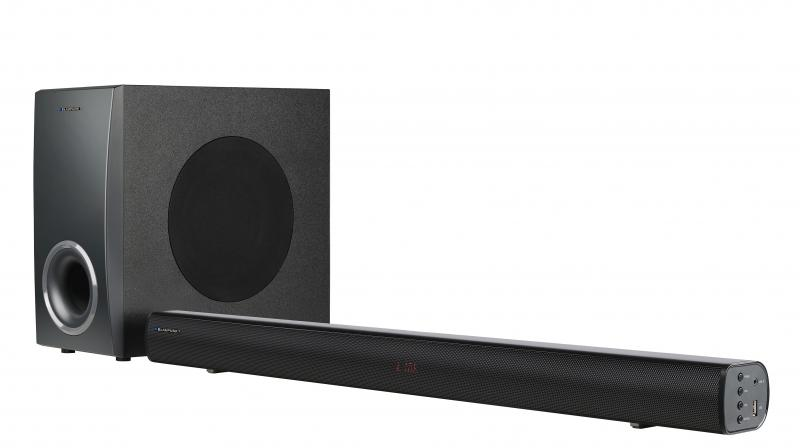 The soundbar supports different audio inputs such as AUX, BT, RCA, & Optical/ Coaxial, HDMI.
