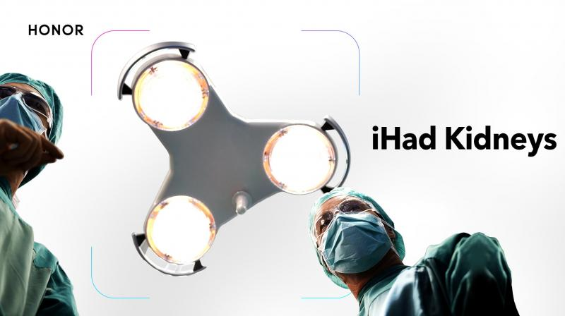The photo says iHad Kidneys and even the light above the surgery table represents the fidget-spinner like triple camera setup that the new iPhones have feature.
