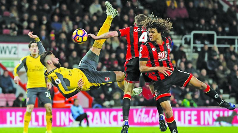 Arsenal staged a sensational fightback from three goals down as Olivier Giroud's last-gasp equaliser rescued a draw at Bournemouth.