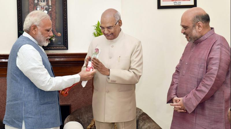 Prime Minister Narendra Modi greets Ram Nath Kovind on being elected as the 14th President of India, as BJP President Amit Shah looks on, in New Delhi. (Photo: PTI)