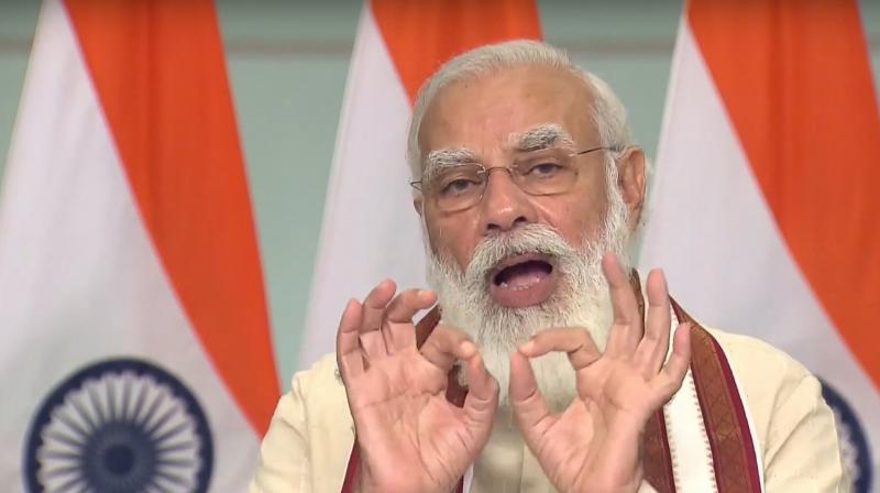 Videograb of prime minister Narendra Modi speaking at the virtual housewarming ceremony for welfare housing built under the PM Awas Yojna in Madhya Pradesh. (PTI)