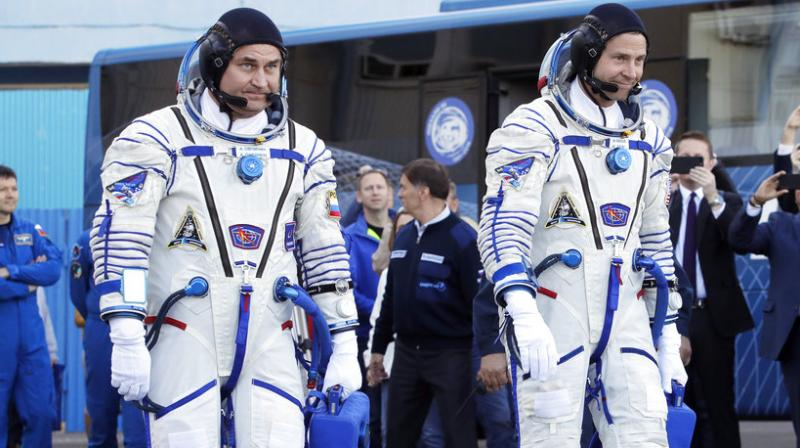 A sensor failure two minutes after launch on Oct. 11 forced Ovchinin and Hague to perform an emergency landing from which they escaped physically unscathed. (AP file Photo/Dmitri Lovetsky, Pool)