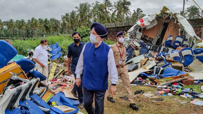 Union civil aviation minister Hardeep Singh Puri inspects the crash site of an Air India Express flight that crashed at the Kozhikode airport on Friday night, August 7, 2020. (PTI)
