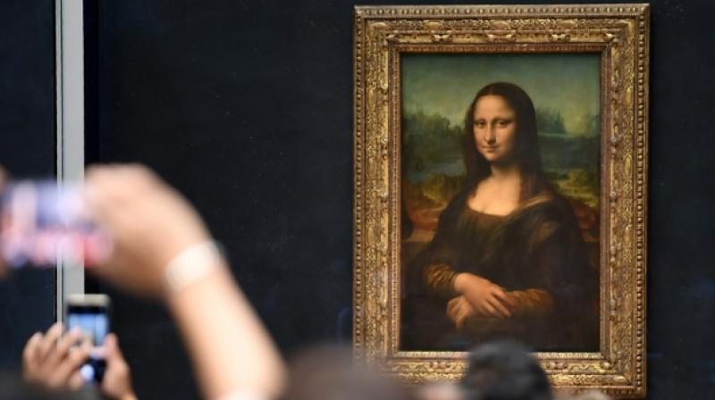 The legendary painting of Mona Lisa will be absent from the show to avoid overcrowding. (Photo: AFP)