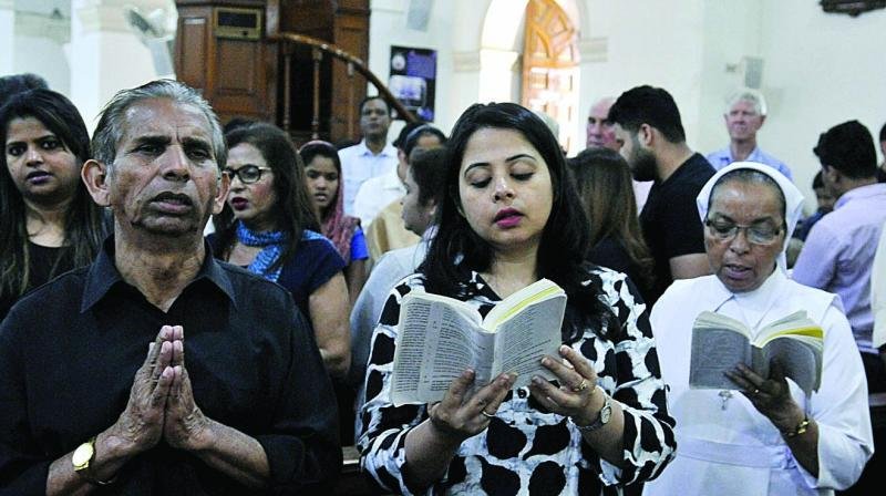Christians participate in a prayer meeting to observe Good Friday at the Sacred Heart Cathedral in New Delhi on Friday. (Photo: Pritam Bandyopadhyay)