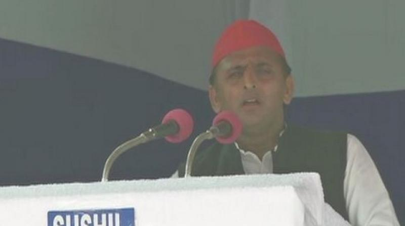 Akhilesh Yadav took a swipe at the Election Commission for handing over a 48-hour ban from poll campaigning to Bahujan Samaj Party supremo Mayawati.  (Image: ANI)