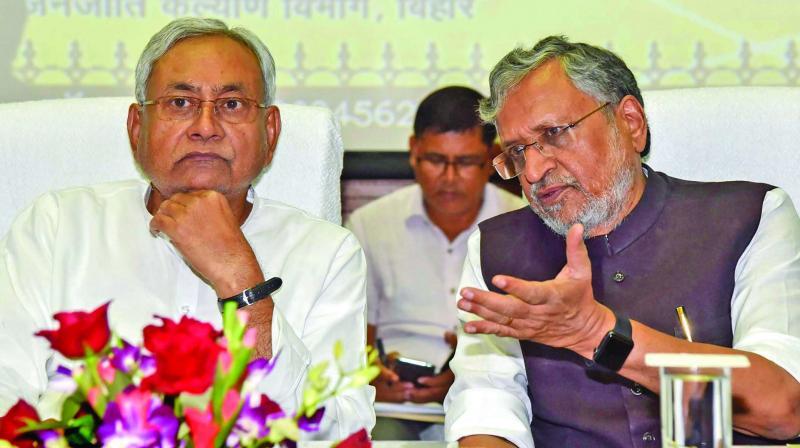 Bihar chief minister Nitish Kumar and Deputy CM Sushil Kumar Modi during the inauguration of Civil Service Incentive Scheme at Adhiveshan Bhawan. (Photo: PTI)