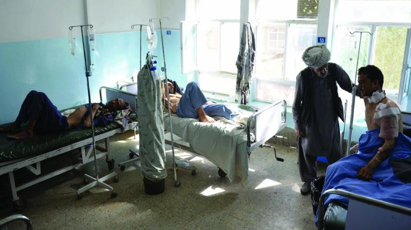 Injured men receive treatment at a hospital in Ghazni province, west of Kabul, Afghanistan on Wednesday. (Photo: AP)
