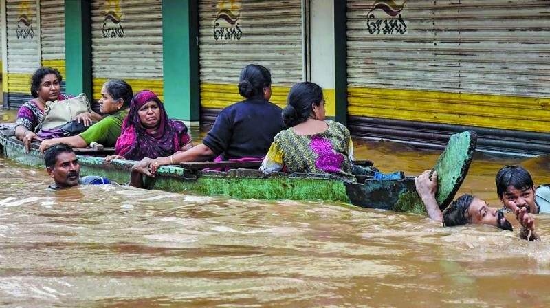 The red alert has been sounded in Alappuzha, Ernakulam and Idukki on Tuesday and in northern districts of Malappuram and Kozhikode on Wednesday, IMD sources said adding over 20 cms of rains are expected in these districts. (Photo: PTI)