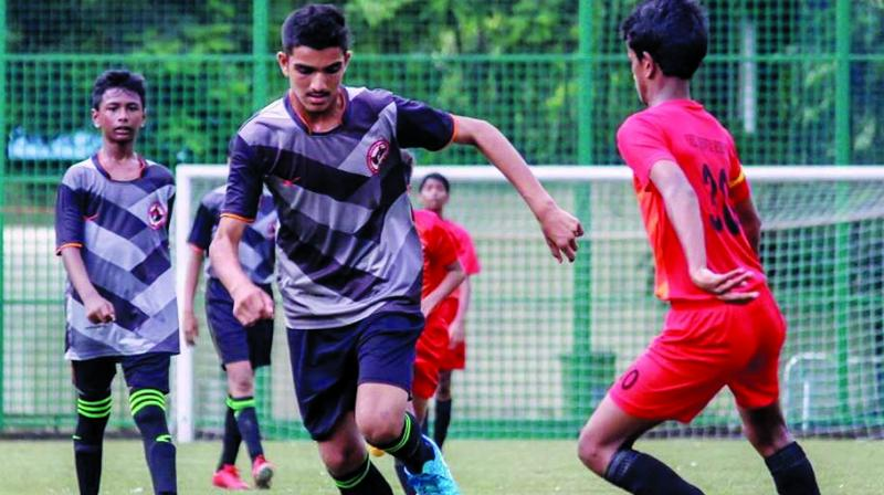 A Nashik United striker controls the ball as he tries to get past a Next Sports defender during their Group-C league match.