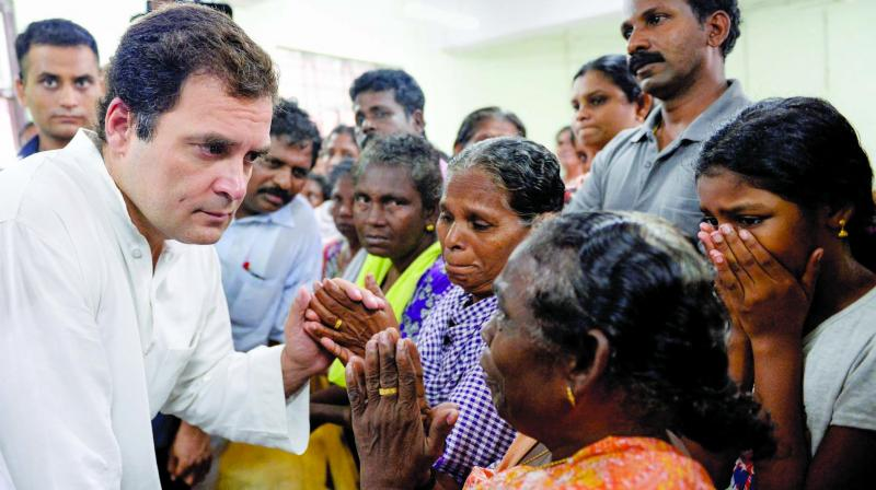 Congress President Rahul Gandhi interacts with the flood-affected people at a relief camp in Chengannur, Kerala on Tuesday. (Photo: PTI)