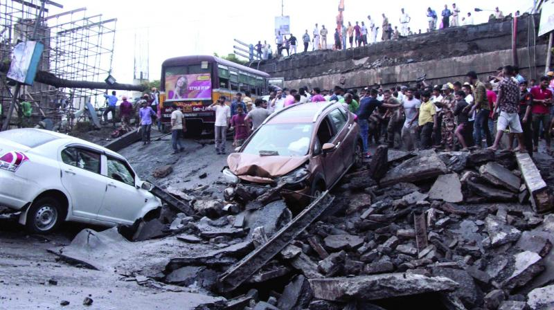 Rescuers work at the scene after a Majherhat Bridge at Taratola collapsed on a sewage canal in Kolkata on Tuesday. (Photo: Abhijit Mukherjee)