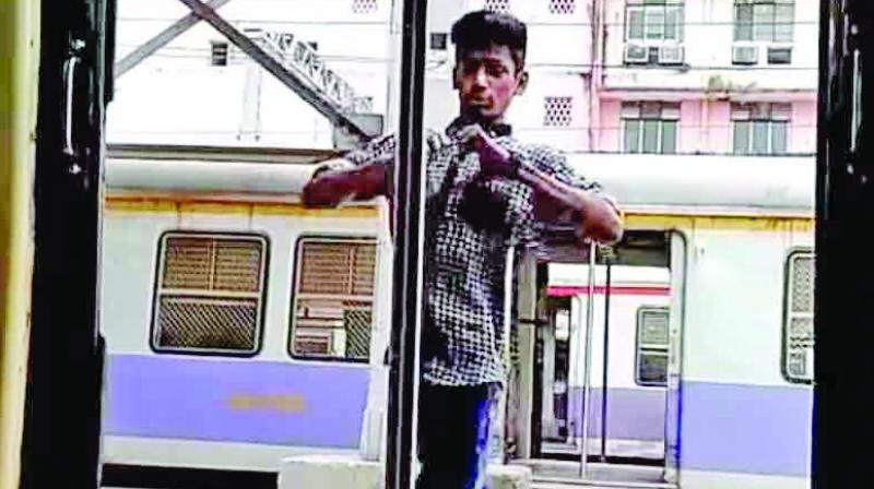 YOuth performing Kiki challenge on railway platform.