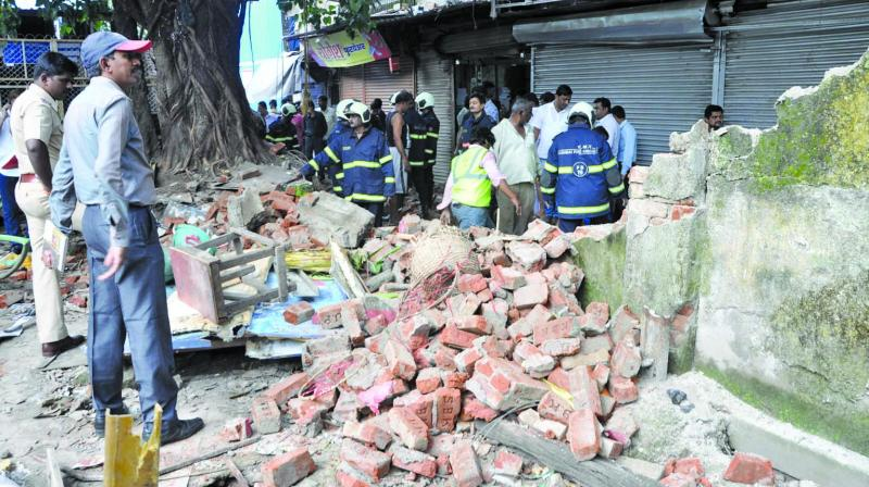 The collapsed wall was made of brick masonry. (Photo: Asian Age)