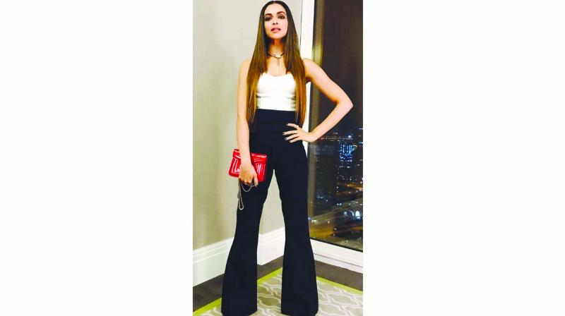 Deepika Padukone slays in her black trousers paired with a contrasting white crop top