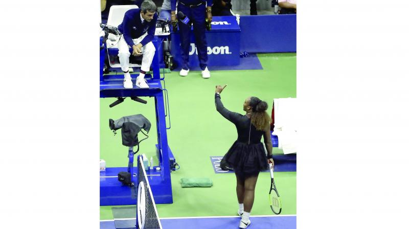 Serena Williams talks with chair umpire Carlos Ramos during the women's final of the US Open tennis tournament in New York on Saturday. (Photo: AP)