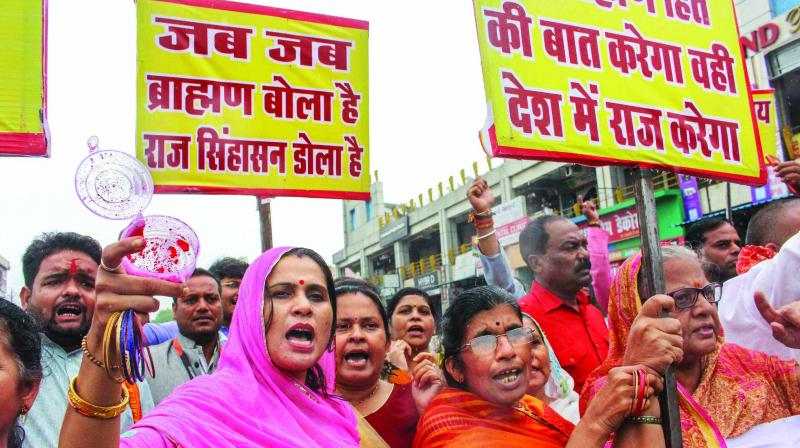 Upper caste protesters hold placards and banners against reservation during 'Bharat Bandh' in Madhya Pradesh.