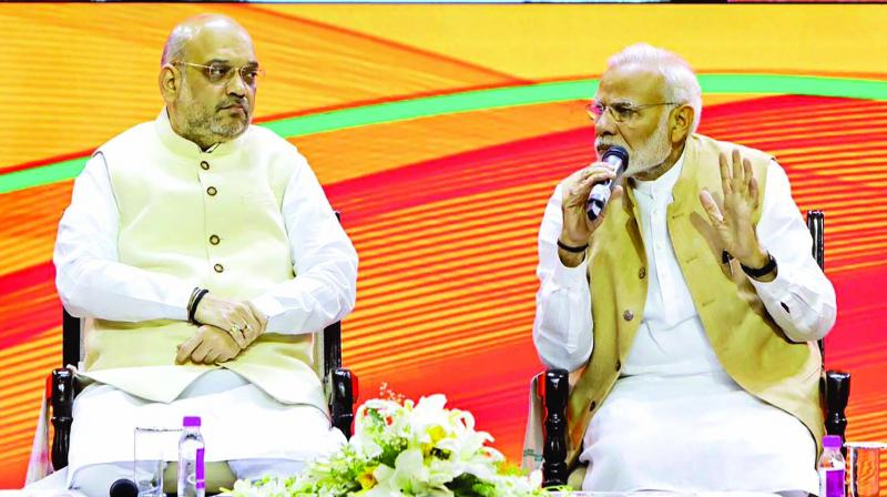 Prime Minister Narendra Modi with BJP president Amit Shah during the BJP national executive meeting in New Delhi on Sunday. (Photo: PTI)