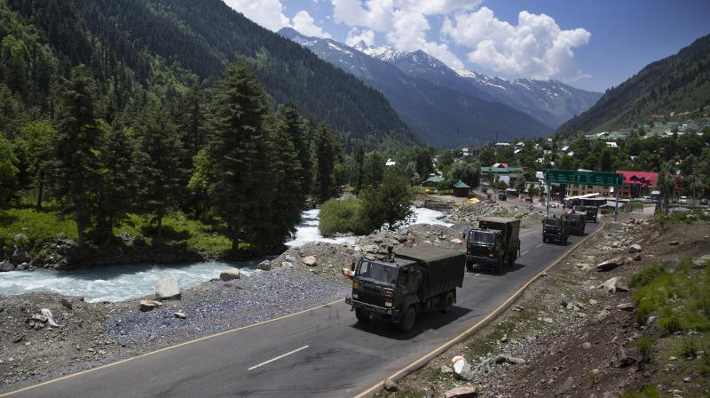 An Indian army convoy moves on the Srinagar- Ladakh highway at Gagangeer, northeast of Srinagar