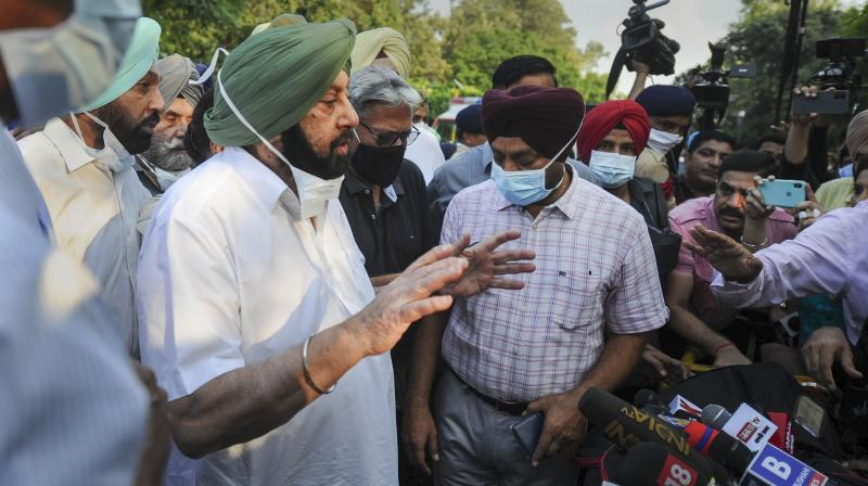 Captain Amarinder Singh speaks to media after submitting his resignation to Governor Purohit Banwarilal at Raj Bhavan in Chandigarh, Saturday, Sept. 18, 2021. (PTI)