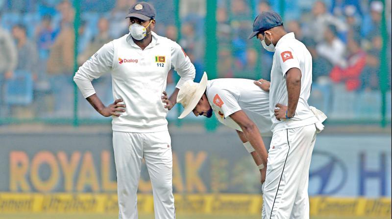 Sri Lanka quick Suranga Lakmal (centre) vomited twice between overs on Tuesday. (Photo: PTI)