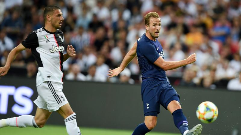 Harry Kane capitalised after team mate Lucas Moura nicked the ball deep into injury time, allowing the striker to thump it from the halfway line high into the steamy night and over the head of Juventus' back-pedalling goalkeeper Wojciech Szczesny. (Photo:AFP)