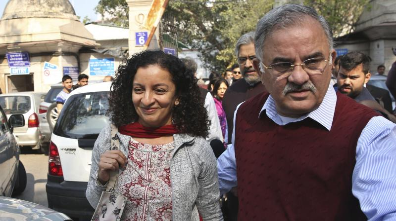 Indian journalist Priya Ramani, left, smiles as she leaves Patiala House Court in New Delhi, India. A New Delhi court on Wednesday, Feb. 17, 2021, acquitted Ramani of criminal defamation after she accused a former editor-turned-politician and junior external affairs minister of sexual harassment. M.J. Akbar, now 70, filed a case against Ramani in Oct. 2018, denying the allegations as false, baseless and wild.(AP)