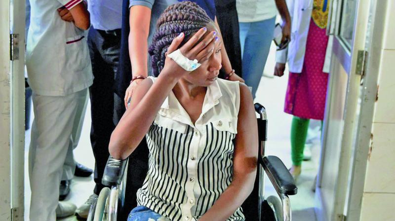 The Kenyan student, who was thrashed by some men, receives treatment at a hospital in Greater Noida. (Photo: PTI)