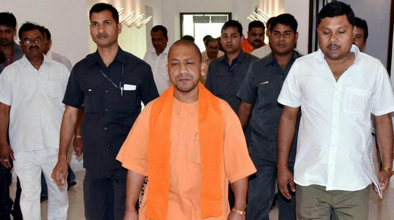 Uttar Pradesh Chief Minister Yogi Aditiyanath entering his official residence in Lucknow. (Photo: PTI)