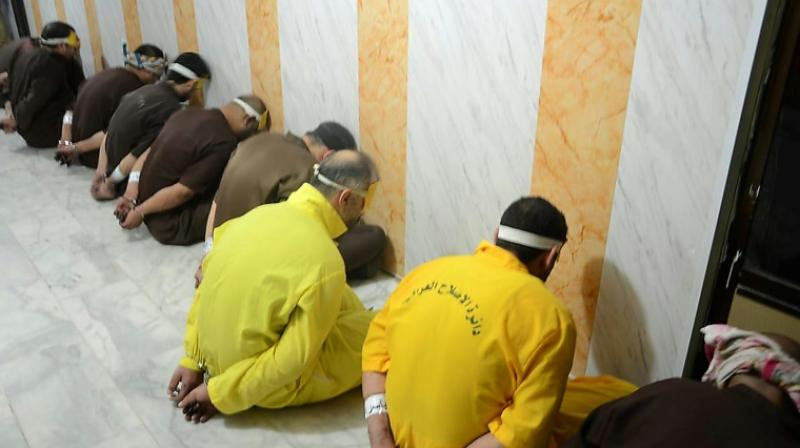 A picture released by the Iraqi justice ministry on June 29, 2018 shows a group of convicted jihadists awaiting execution. (Photo: AFP)