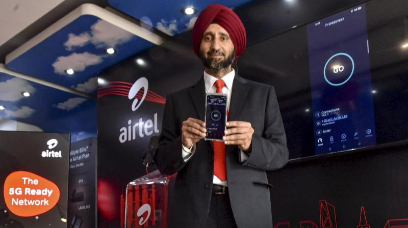 Avneet Singh Puri, Bharti Airtel CEO for Andhra Pradesh and Telangana, demonstrates the country's first Live 5G service over a commercial network, at an outlet in Hyderabad. (Photo:PTI)