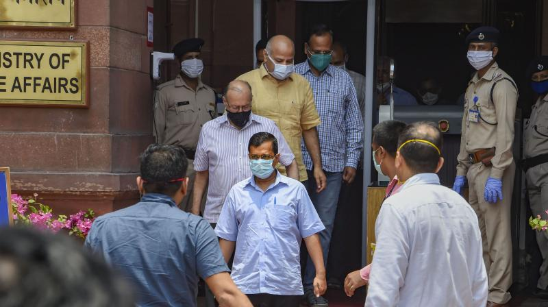 Delhi's CM Arvind Kejriwal, Lt Governor Anil Baijal, Dy CM Manish Sisodia and Health Minister Satyender Jain leave North Block after attending a meeting with Union Home Minister Amit Shah to discuss the COVID-19 situation, in New Delhi. PTI