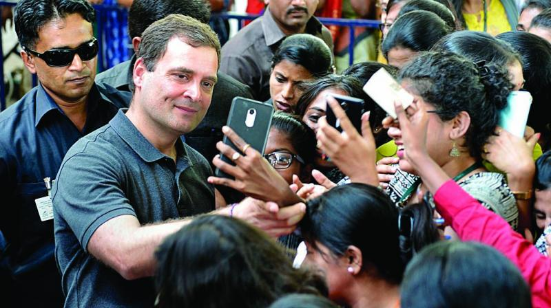 Congress president Rahul Gandhi takes a selfie with students at Stella Maris Women's College in Chennai on Wednesday. (Photo: PTI)
