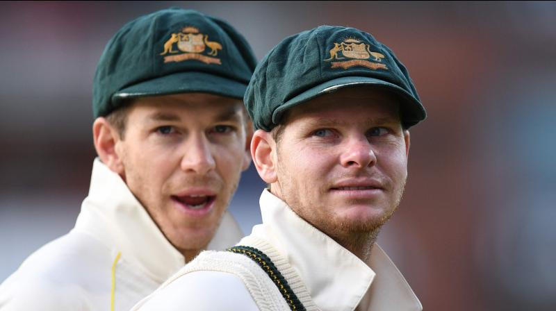 Australia's captain Tim Paine and Steve Smith celebrate their victory after the fourth Ashes cricket Test match between England and Australia at Old Trafford in Manchester.  Australia retained the Ashes with a 185-run thrashing of England in the fourth Test at Old Trafford on Sunday. (Photo:AFP)