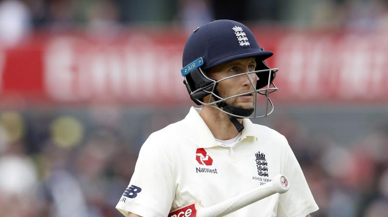 Joe Root's captaincy has come under scrutiny after England's failure to regain the Ashes but Tim Paine said Australia would not underestimate him. (Photo:AFP)