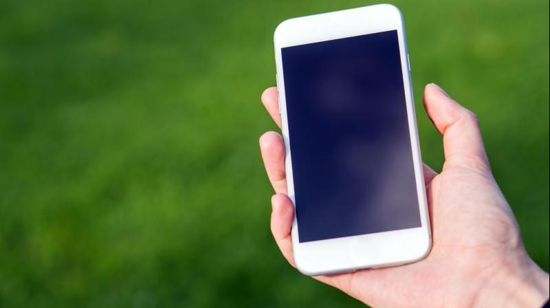Reflection is the major reason it is difficult to read a phone screen in bright sunlight, as the strong light reflecting off the screen's surface washes out the display. (representational image)