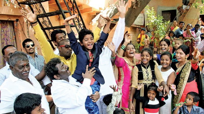 Child actor Sunny Pawar, who made his debut in Hollywood movie Lion, receives a warm welcome by his family and neighbours on his return outside his residence in Kalina, Santa Cruz on Wednesday. (Photo: Mrugesh Bandiwadekar)