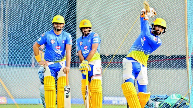 Ravindra Jadeja of Chennai Super Kings plays a shot as teammates Suresh Raina (left) and A. T. Rayudu watch during a practice session on Thursday, eve of Qualifier-2 at the ACA-VDCA Stadium in Visakhapatnam. (Photo: K Murali Krishna)