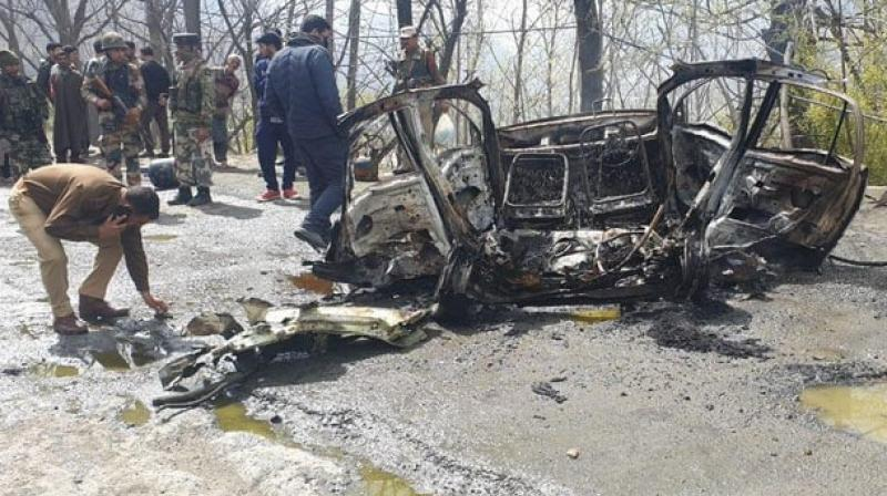 A CRPF vehicle had suffered slight damage when a Santro car went up in flames after an explosion at Tethar village, seven kms from Banihal, shortly after a Jammu-bound convoy crossed the Jawahar Tunnel, the gateway to Kashmir valley.  (Photo: ANI)
