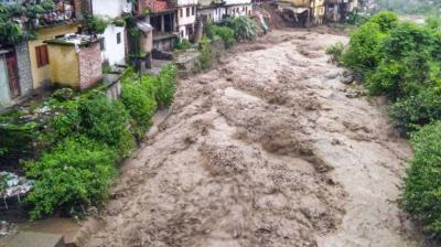 Flood water gushes down after a cloudburst in Chamoli district on Aug 12, 2019. A woman was buried alive while five others were trapped in the rubble on Monday as landslides triggered by heavy rains hit three different places in the watershed area of Chuflagad, a tributary of Nandakini River in Uttarakhand's Chamoli district. (Photo: PTI)