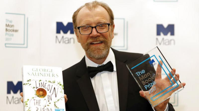 Author George Saunders of the United States with his book 'Lincoln in the Bardo' during a photocall after being announced winner of the 2017 Man Booker Prize, in London. (Photo: AP)