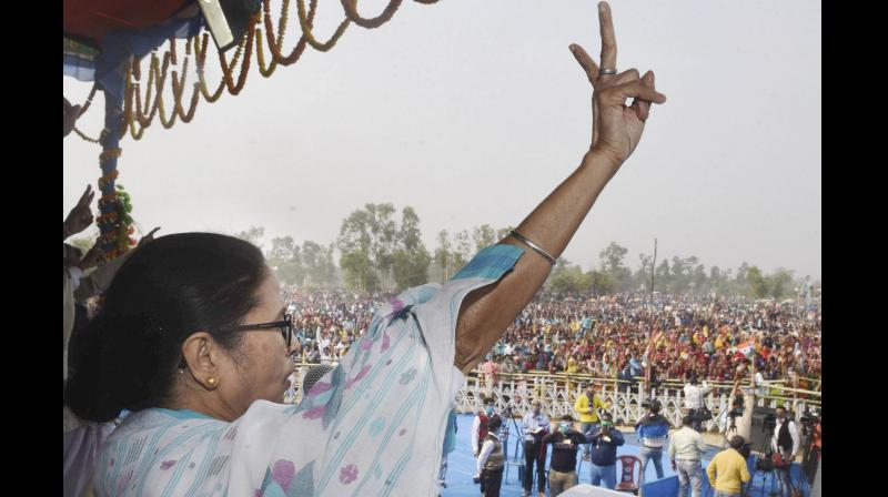 In her first visit to Mr Adhikari's home turf after his induction to the BJP, the West Bengal chief minister also declared that she would also try to contest from her home constituency Bhowanipore. (Photo:PTI)