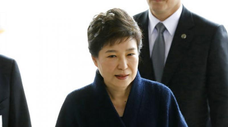 Prosecutors accuse Park of colluding with a confidante to extort big businesses, take a bribe from one of the companies and commit other wrongdoing. (Photo: AP)