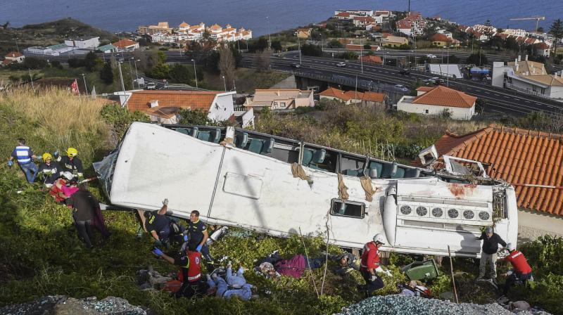Drone footage of the aftermath of the accident showed the badly mangled wreckage of the bus resting precariously on its side. (Photo:AP)
