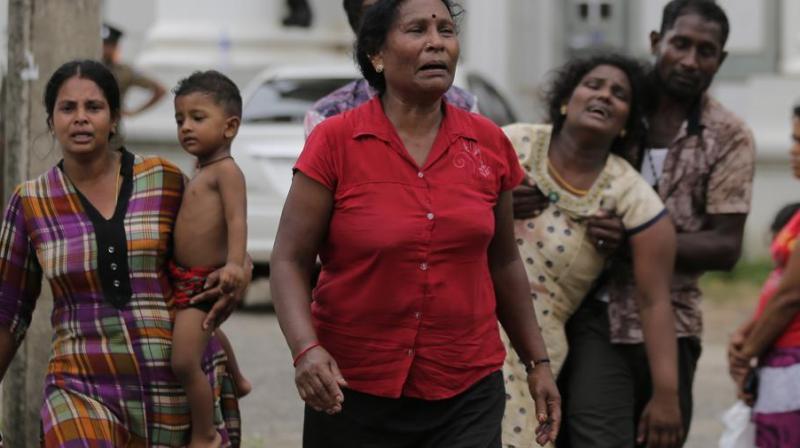 Relatives of a blast victim grieve outside a morgue in Colombo, Sri Lanka, Sunday, April 21, 2019. (Photo: AP)