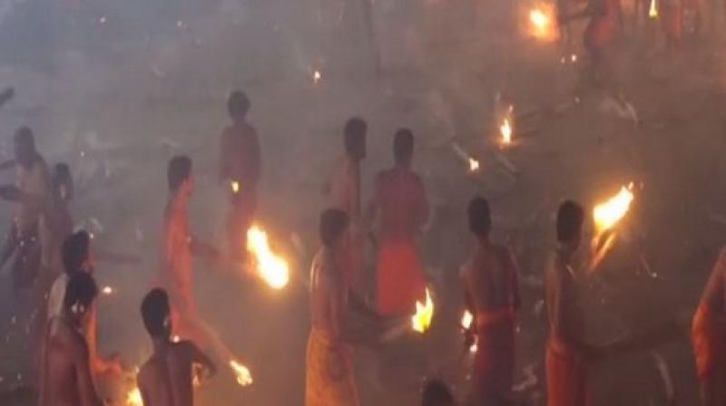 According to the rules of the festival, the men are divided into two groups and are permitted five throws to hit as many people in the other group. (Photo: ANI)